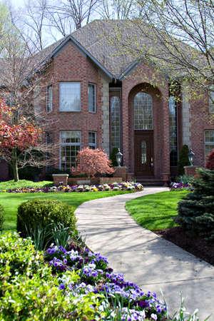 walkway: A scenic sidewalk to a beautiful home.
