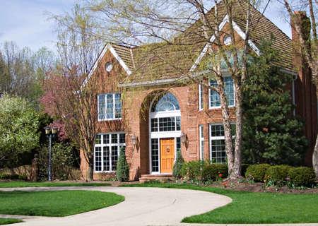 Beautiful suburban Ohio home - driveway sweeps up photo