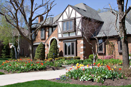 tudor: Beautiful tudor home beautifully landscaped with tulips - Ohio.