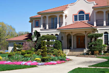 spanish style: A Spanish style architecture - home in Ohio, blue sky, pretty flowers.