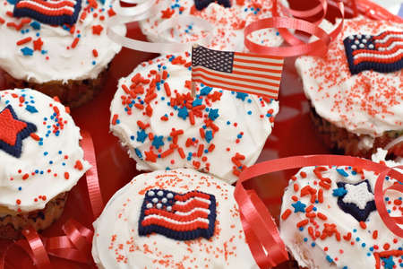 A plate of colorful American holiday celebration cupcakes.  photo
