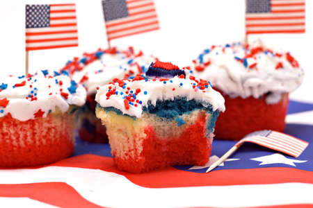 A red, white and blue stiped cupcake with a bite taken. Stock Photo - 919273