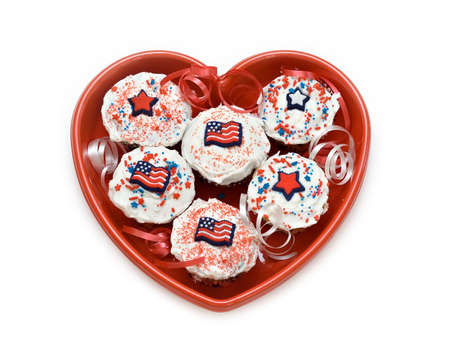 American theme cupcakes in a heart-shaped dish.   photo