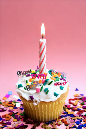 A party cupcake with pink candle and pink background. Stock Photo - 919276