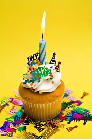 sweetest: Birthday party cupcake on yellow background.  Stock Photo