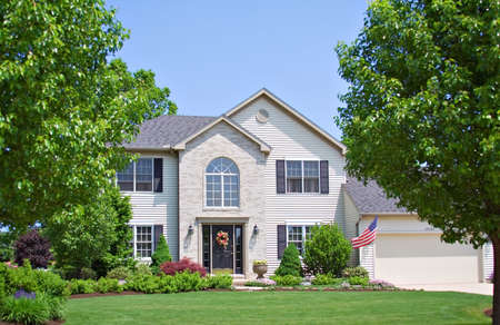 A suburban home in Ohio - American flag for Memorial Day. Stock Photo - 965403