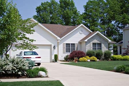 Beautiful home in an American suburban neighborhood - car in driveway.