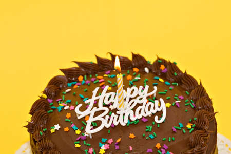 A chocolate birthday cake with candle and words. Stock Photo - 965414