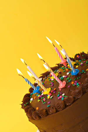 A diagonal shot of birthday or anniversary cake with lit candles. Stock Photo - 965420