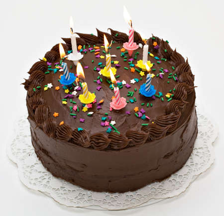 sweetest: Chocolate-lovers birthday cake with lit candles.