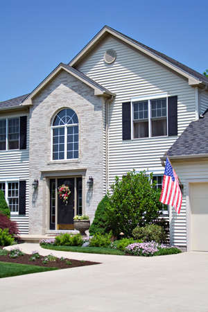 An American home proudly displays the flag.