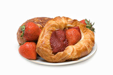 afternoon break: A plate of pastries, danish and strawberries isolated on white. Stock Photo