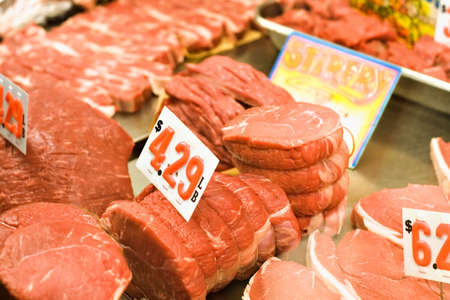 side of beef: A butchers meat case at the Cleveland West Side Market - lots of red beef.