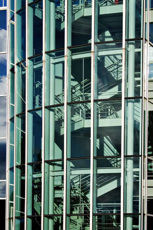 comprised: Un moderno edificio composto di vetro e acciaio - scale visibili - astratto.