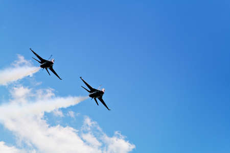 Two F16 Thunderbirds approaching Cleveland Hopkins Airport for a landing.