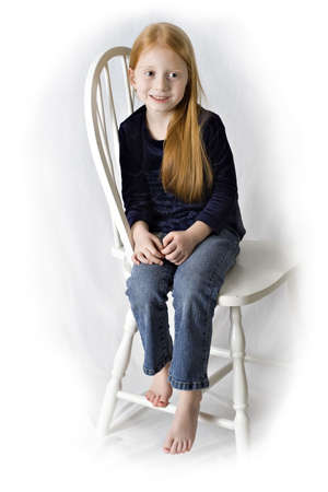 Cute red haired girl wearing blue jeans.