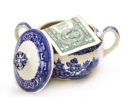 stash: An American dollar in a sugar bowl.  Concept about economy and savings.  Stock Photo