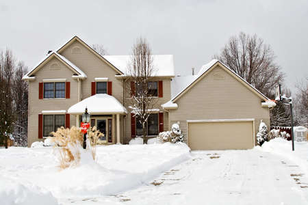 A suburban residential home during winter in Ohio, US.