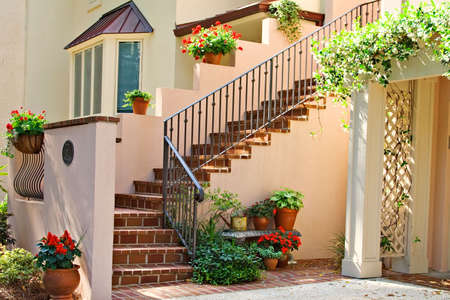 An exclusive neighborhood in Harbour Town, Hilton Head, SC.  Condominium entrance stairway decorated with flowers.