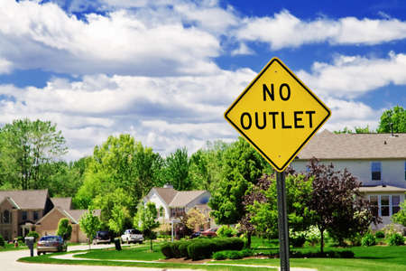 suburbs: A no oulet sign at the entrance to a beautiful suburban neighborhood. Stock Photo