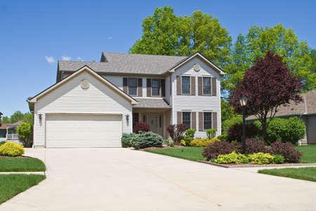 suburban neighborhood: Wide angle view of neat colorful surburban home and landscape.