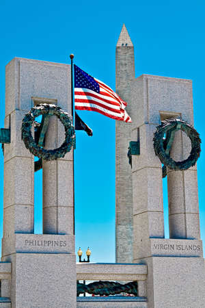 World War II memorial in Washington DC.  Washington monument visible in background.   Editorial