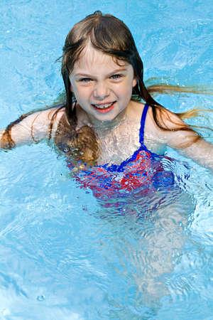 Small girl swimming in water - seasonal - vacation, summer.  Stok Fotoğraf