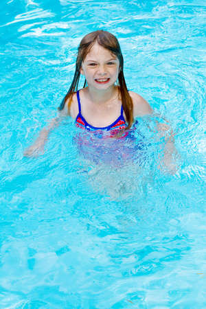A small girl with big smile in a swimming pool. Stock Photo - 3146677