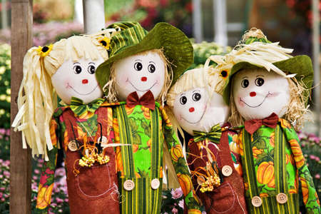 Four scarecrows boys and girls smiling. photo