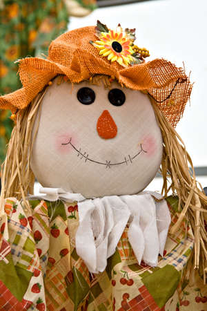 A cute fall scarecrow decoration. Stock Photo
