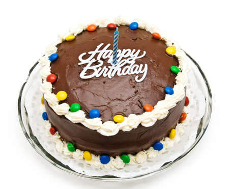 A chocolate birthday cake with candy, candle and icing. Stock Photo - 3717605