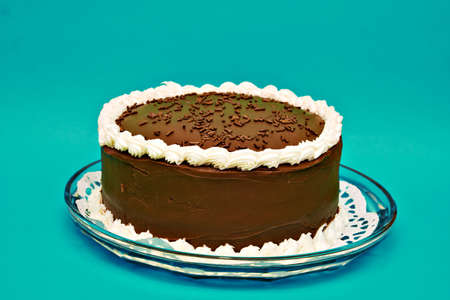 sweetest: A chocolate cake on turquoise background.  Stock Photo