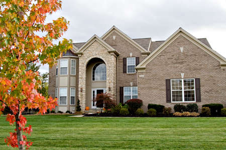 A brick and stone suburban home - nice landscaping. Stock Photo - 3726111