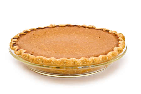 pumpkin pie: A whole home made pumpkin pie fresh from my oven - white background. Stock Photo