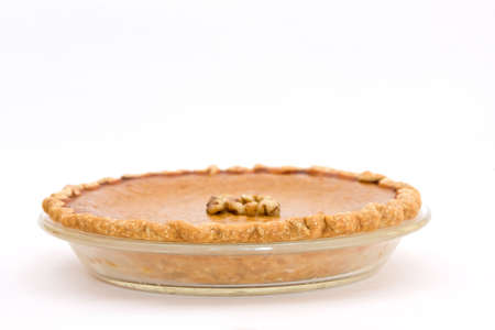 Fresh from my oven. Home made pumpkin pie in glass pie dish on white background. Stock Photo - 3947526