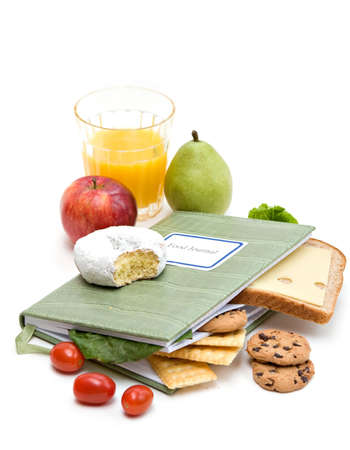 Food Journal or diary surrounded with different foods.  Health and diet concept. photo