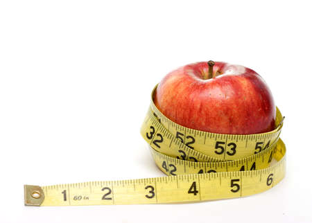 Red apple and measuring tape isolated on white background - diet, health concept.