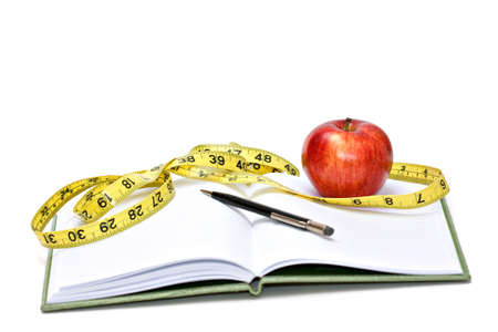 Journal, tape measure and apple - diet concept Stock Photo