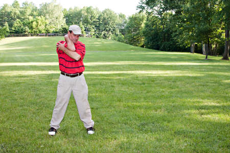 Man doing several stretching exercises before round of golf.