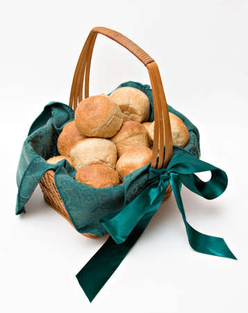 holiday meal: A basket of freshly baked homemade  whole-wheat dinner rolls ready for a holiday meal.  Stock Photo