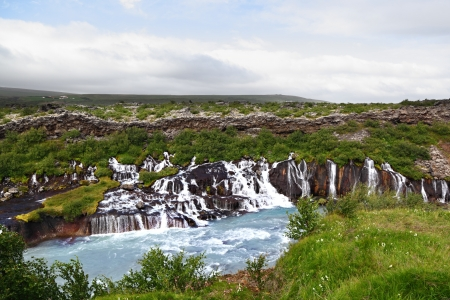 Hraunfossar  lava falls  waterfall with blue waters, Iceland