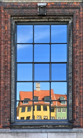 Wonderful Copenhagen with colorful buildings reflected in ornate window