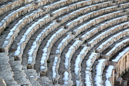 Snow on the seats of the Roman Theater at Jerash Stock Photo