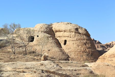 Desert Landscape with Rock-Cut Tombs at Petra
