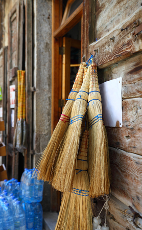 Lebanon- traditional straw brooms on sale in the village market Stock Photo