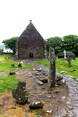 irish culture: Ogham Stone in abandoned churchyard, Ireland Stock Photo