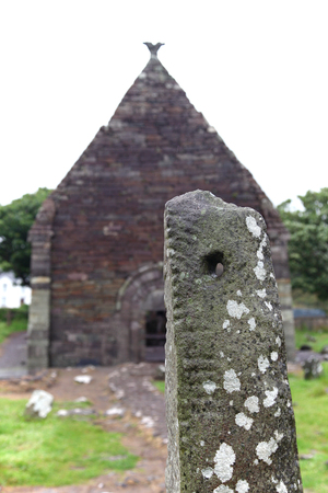 Ogham Stone in abandoned churchyard, Ireland Stock Photo