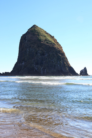 The Haystack Rock at Cannon Beach, Oregon Stock Photo