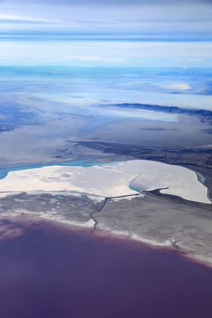 The Great Salt Lake, Utah - The northern part is more saline and has bacteria that turn the water a pinkish purple color.