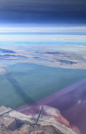 The Great Salt Lake, Utah - a causeway divides the northern from the southern part of the lake. The northern part is more saline and has bacteria that turn the water a pinkish purple color.